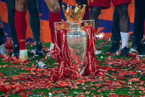 LIVERPOOL, ENGLAND - Wednesday, July 22, 2020: The Premier League trophy dressed in red ribbons during the presentation after the FA Premier League match between Liverpool FC and Chelsea FC at Anfield. The game was played behind closed doors due to the UK government's social distancing laws during the Coronavirus COVID-19 Pandemic. (Pic by David Rawcliffe/Propaganda)