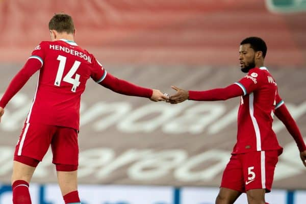 LIVERPOOL, ENGLAND - Saturday, February 20, 2021: Liverpool's captain Jordan Henderson hands the captain's armband to Georginio Wijnaldum (R) as he walks off injured during the FA Premier League match between Liverpool FC and Everton FC, the 238th Merseyside Derby, at Anfield. Everton won 2-0, the club's first win at Anfield since 1999. (Pic by David Rawcliffe/Propaganda)