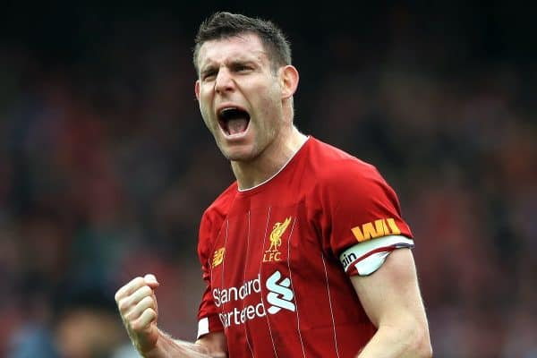 Liverpool's James Milner celebrates their victory after the final whistle at the Premier League match at Anfield, Liverpool.