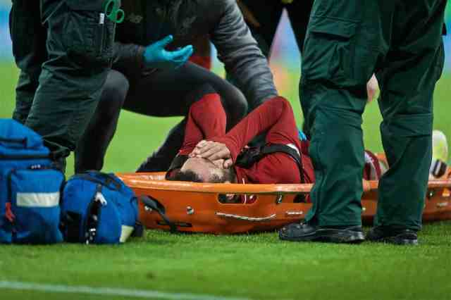 NEWCASTLE-UPON-TYNE, ENGLAND - Saturday, May 4, 2019: Liverpool's Mohamed Salah dis treated for an injury during the FA Premier League match between Newcastle United FC and Liverpool FC at St. James' Park. (Pic by David Rawcliffe/Propaganda)