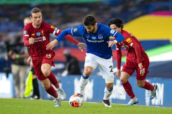 LIVERPOOL, ENGLAND - Sunday, June 21, 2019: Everton's André Gomes gets away from Liverpool's captain Jordan Henderson during the FA Premier League match between Everton FC and Liverpool FC, the 236th Merseyside Derby, at Goodison Park. The game was played behind closed doors due to the UK government's social distancing laws during the Coronavirus COVID-19 Pandemic. (Pic by David Rawcliffe/Propaganda)
