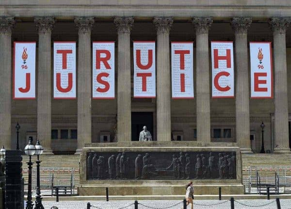 A giant banner is unveiled at St George's Hall in Liverpool after the inquest jury ruled the 96 victims in the Hillsborough disaster had been unlawfully killed. (Picture by: PA / PA Wire/Press Association Images)