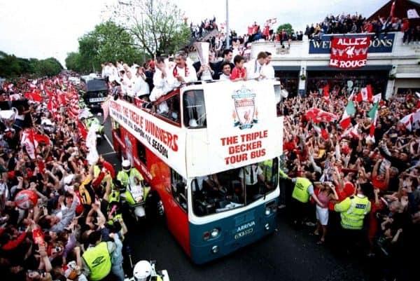 Liverpool fans line the streets as the team parade the three trophies won during season 2000-2001 season ( Matthew Ashton/EMPICS Sport)