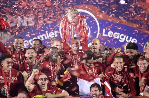 Liverpool's Jordan Henderson lifts the English Premier League trophy during the Premier League match at Anfield, Liverpool. (PA-54697236)