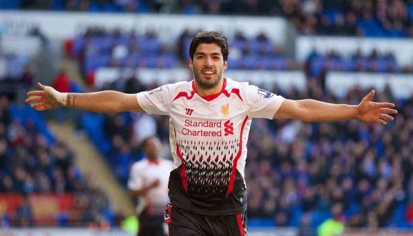 CARDIFF, WALES - Saturday, March 22, 2014: Liverpool's Luis Suarez celebrates scoring the sixth goal against Cardiff City during the Premiership match at the Cardiff City Stadium. (Pic by David Rawcliffe/Propaganda)