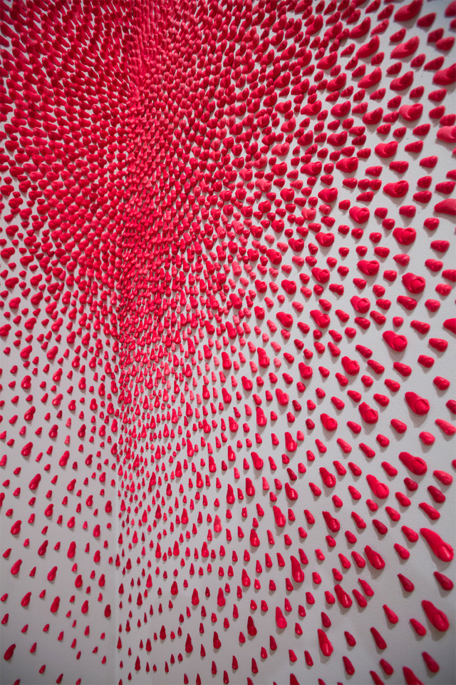 Hundreds of Pink Fingers and Toes Explode on Gallery Walls multiples installation fingers anatomy