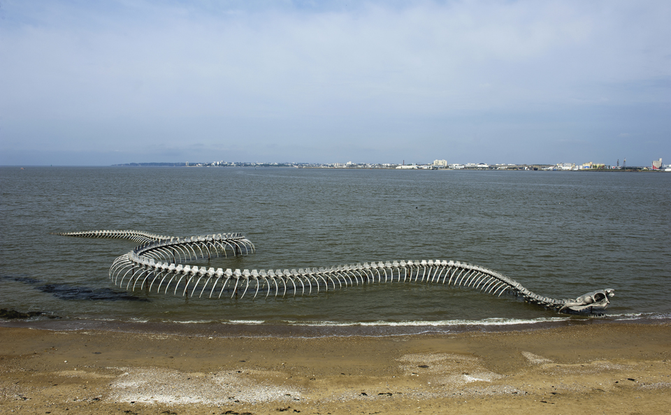 A Giant Twisting Serpent Skeleton Emerges from the Loire River in France snakes sculpture France bones anatomy