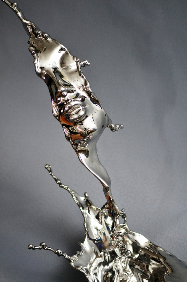 Human Faces Emerge from Splashes of Stainless Steel by Johnson Tsang sculpture