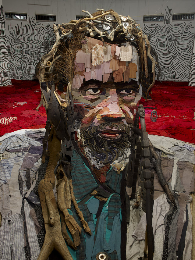 This Anamorphic Portrait by Bernard Pras is Made From an Entire Room of Objects portraits assemblage anamorphism