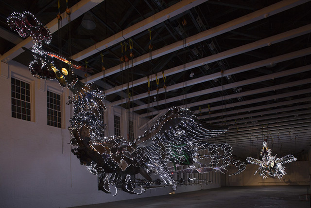 Xu Bing Arrives at Mass MoCA With His 12 Ton Birds Made of Construction Equipment sculpture light construction birds assemblage