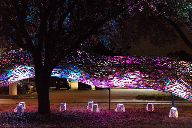 The Funnel Tunnel Snakes its Way Through the Streets of Houston wood installation