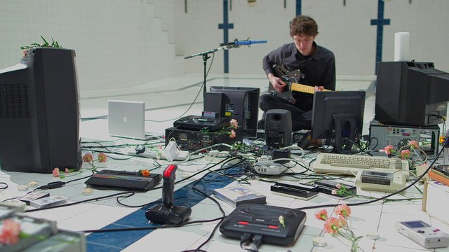Polybius: James Houston Makes Music with Old Technology Including a SEGA Mega Drive, Commodore 64, and Floppy Drives  music video