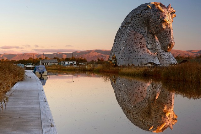 Giant Kelpies Horse Head Sculptures Tower Over the Forth & Clyde Canal in Scotland sculpture Scotland horses