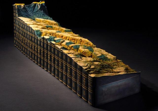 Artist Guy Laramée Carves a Mountainous Landscape from an Encyclopedia Britannica Set sculpture mountains books