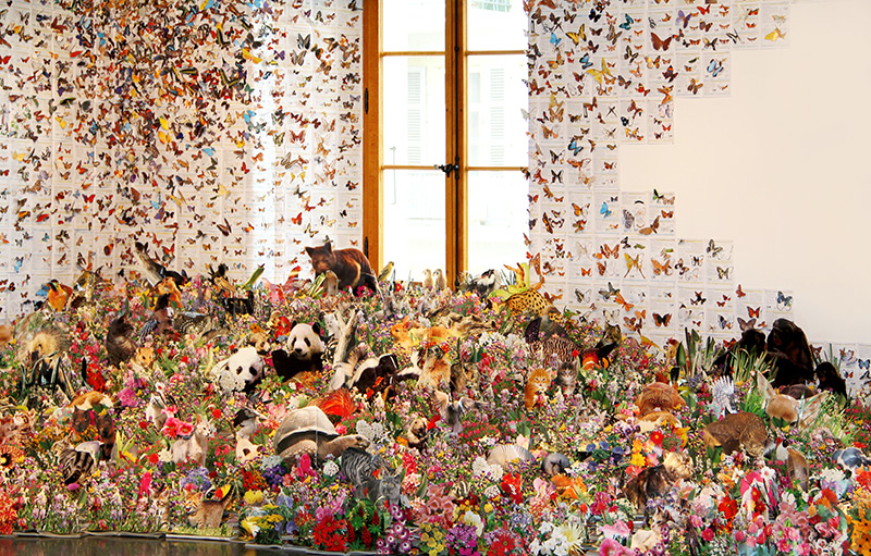 Flora and Fauna Escape the Confines of Over 1,000 Repurposed Books paper installation collage books