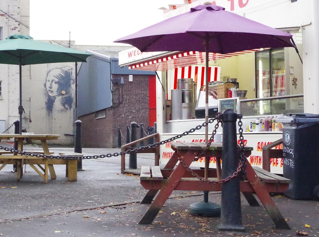 Girl with a Pierced Eardrum by Banksy street art murals