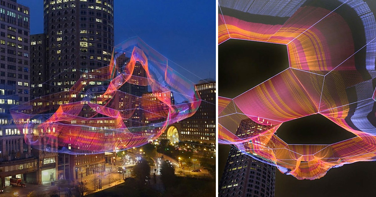 A Monumental Sculpture Of Colorful Twine Netting Suspended Above Boston Colossal