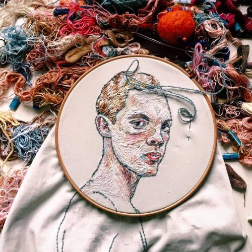 Embroidered Art Lisa Smirnova Embroideries Thread Painting In Progress Tattooed Man Surrounded by Threads Yarn and Floss