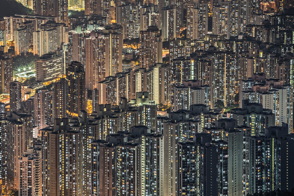 This amazing stacked architecture of Hong Kong shows the housing of its rather dense population. It's visually striking to understand that your whole horizon is built from people's lit windows. It shocks you that each life so big and important to the person himself and his close circle looks just like a tiny star in a huge sky next to millions of the same stars.