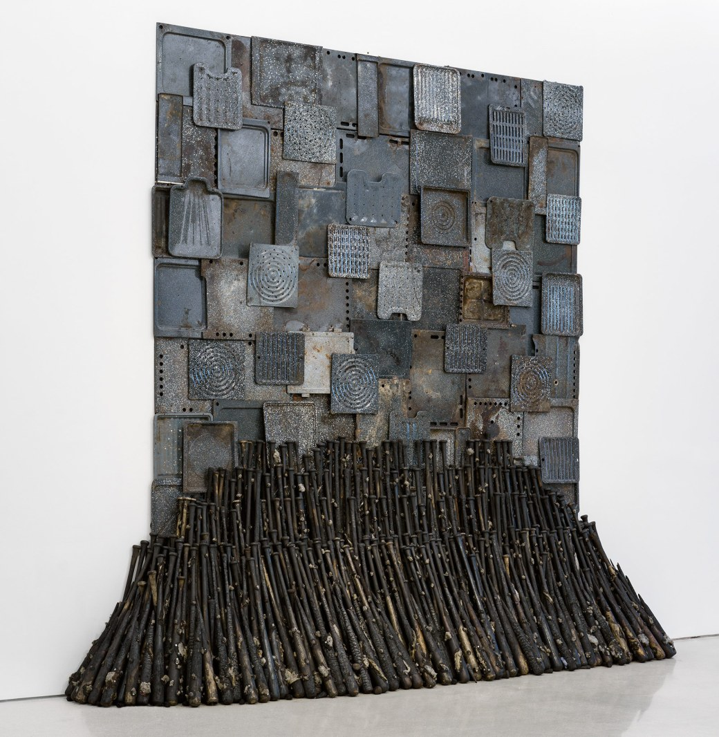 """""""Iron Heavens"""" (1995), oven pans, ironed sterilized cotton, and burnt wooden bats, 140 x 148 x 48 inches, Nari Ward"""