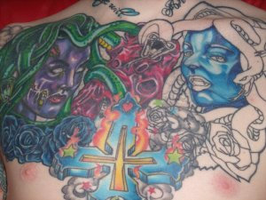 Chest Piece by Oz, Cross by Chris Jones