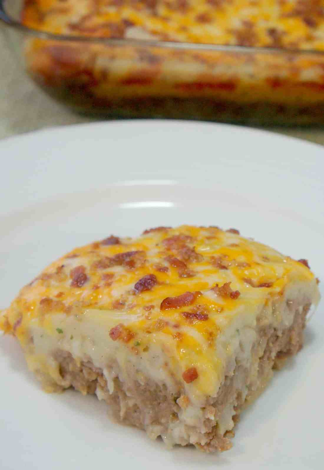 Loaded Potato Meatloaf Casserole. Ground beef meatloaf topped with garlicky instant mashed potatoes, cheese and bacon. Easy dinner recipe.