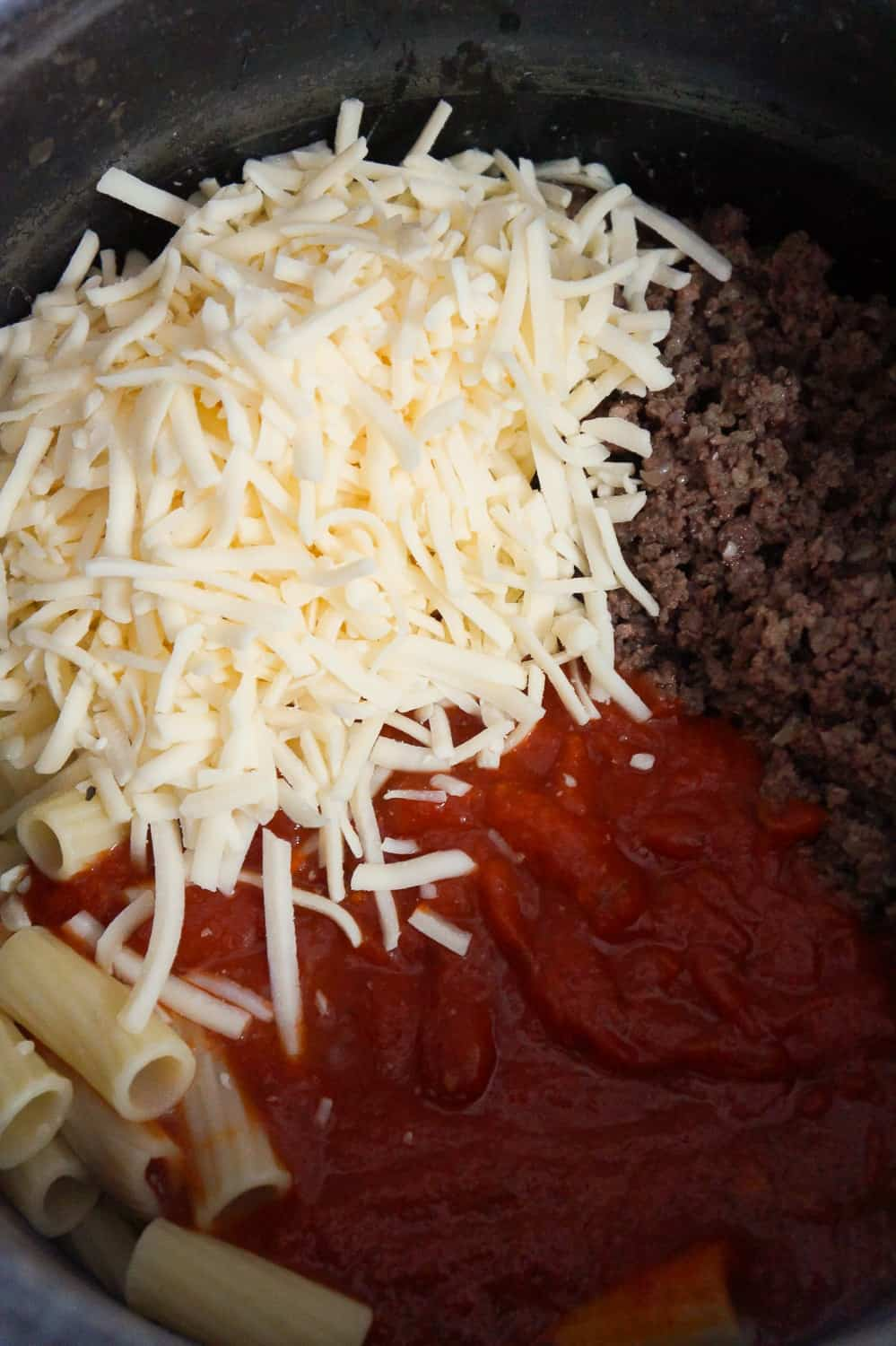 shredded mozzarella, cooked ground beef and marinara sauce dumped on top of rigatoni noodles.