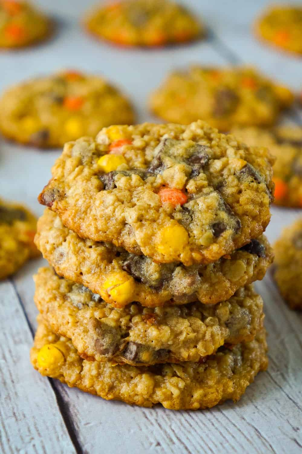 Peanut Butter Oatmeal Cookies with Chocolate Chunks are the perfect dessert recipe for peanut butter lovers. These oatmeal cookies are loaded with mini Reese's Pieces, milk chocolate chips and chocolate chunks.