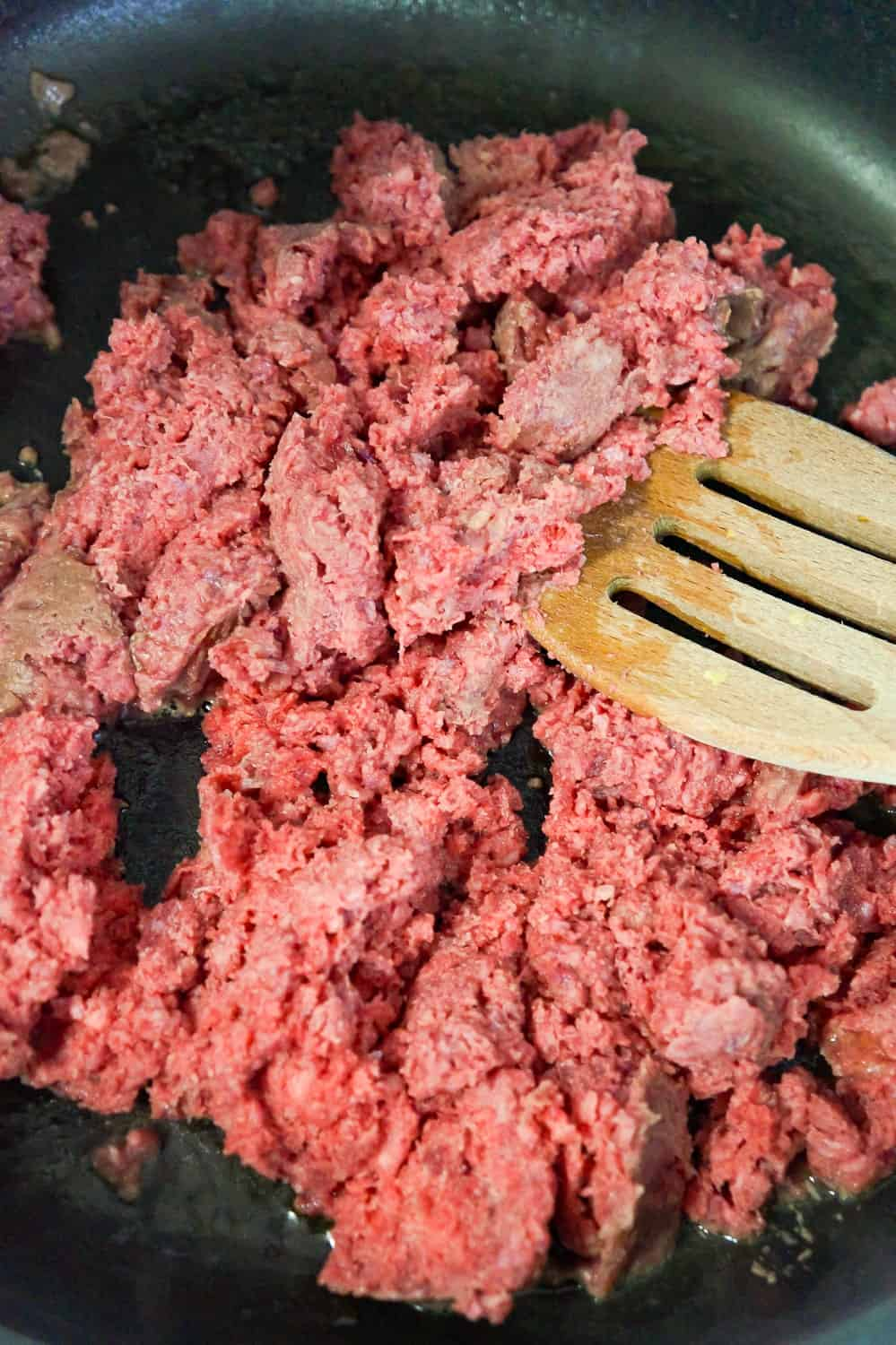 ground beef cooking in a frying pan