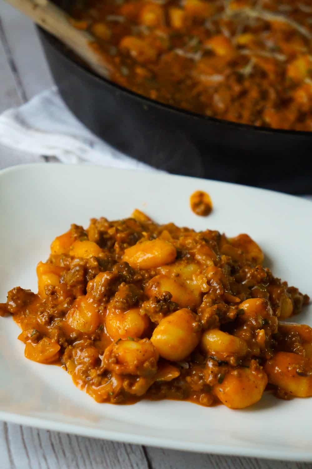 Gnocchi and Ground Beef with Tomato Sauce is an easy weeknight dinner recipe that takes less than 30 minutes from start to finish. These delicious mini potato dumpling are tossed in a sauce made from condensed tomato soup, along with some ground beef and real bacon bits.