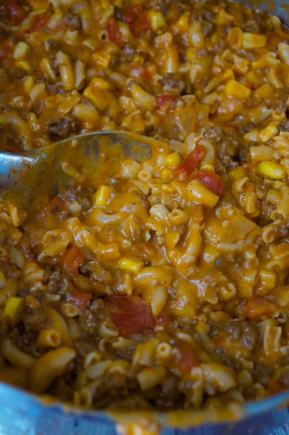 Cheesy Beef Goulash with Corn is an easy weeknight dinner recipe that takes less than 30 minutes from start to finish. This one pot dinner is loaded with diced tomatoes, macaroni noodles, ground beef corn and mozzarella cheese.