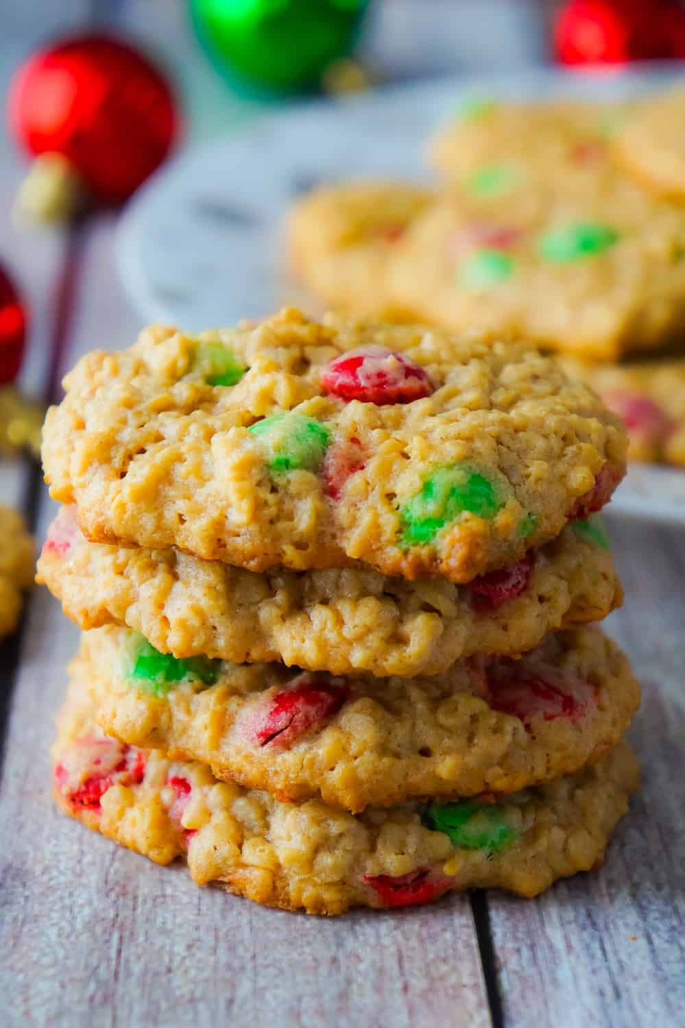 Christmas Monster Cookies are delicious oatmeal peanut butter cookies loaded with red and green M&Ms. These flourless oatmeal cookies would be the perfect addition to your Christmas baking.