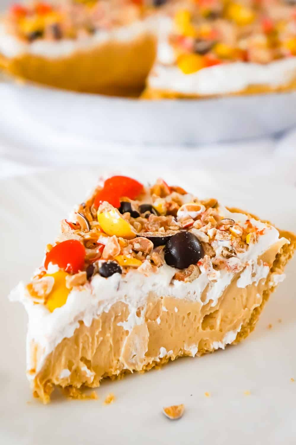 Peanut Butter Pie is an easy no bake dessert for peanut butter lovers. This no bake pie has a rich and creamy peanut butter filling, in a store bought graham crust and is topped with Cool Whip and Reese's Pieces Peanut candies.