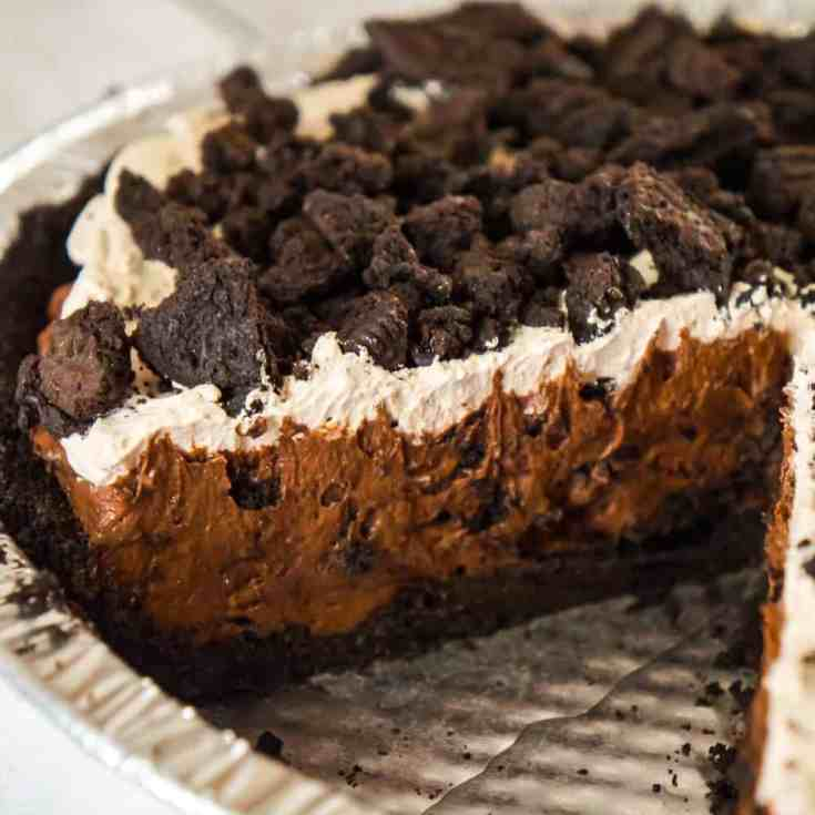 Chocolate Oreo Pie is an easy no bake dessert recipe perfect for when you don't feel like turning on the oven. This decadent pie is made with chocolate instant pudding mix and loaded with Dark Chocolate Oreo cookies.