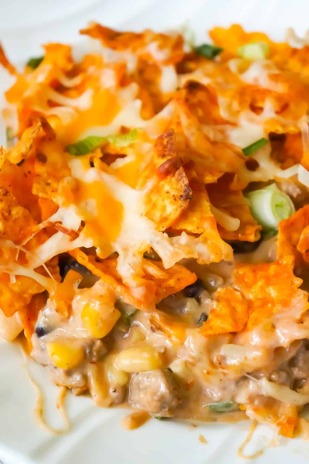 Doritos Casserole with Ground Beef is an easy dinner recipe the whole family will love. This hearty casserole is loaded with ground beef, cream cheese, corn, black beans, shredded cheese and topped with crumbled Doritos.