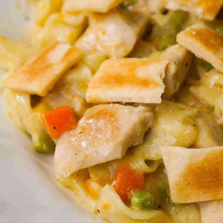 Instant Pot Chicken Pot Pie Pasta is an easy chicken dinner recipe perfect for when you are short on time. This creamy egg noodle pasta is loaded with chicken breast, veggies and topped with strips of Pillsbury pie crust.
