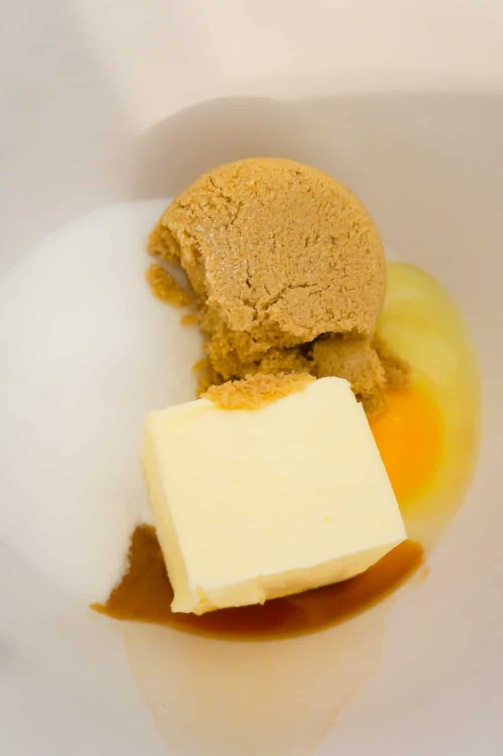 light brown sugar, granulated sugar, butter, an egg and vanilla extract in a mixing bowl