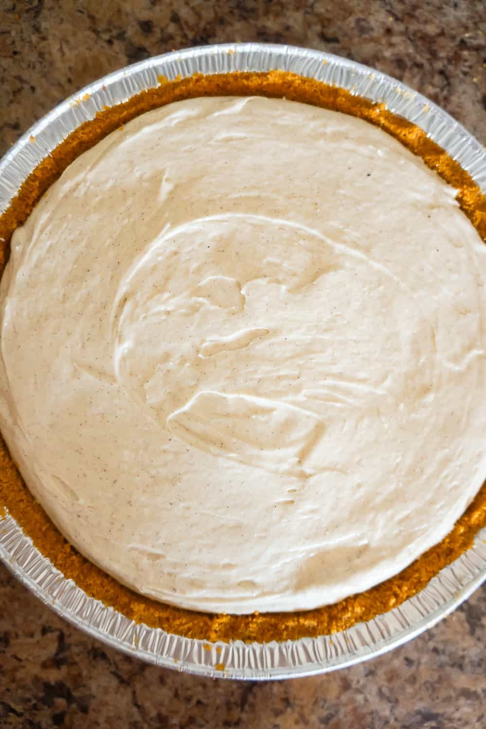 pumpkin spice cheesecake filling in a graham pie crust