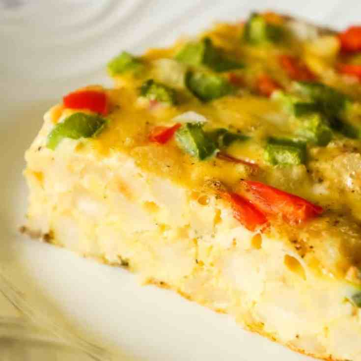 Egg Casserole with Hash Browns is a an easy breakfast recipe made with diced hash brown potatoes and loaded with onions, green peppers and red peppers.