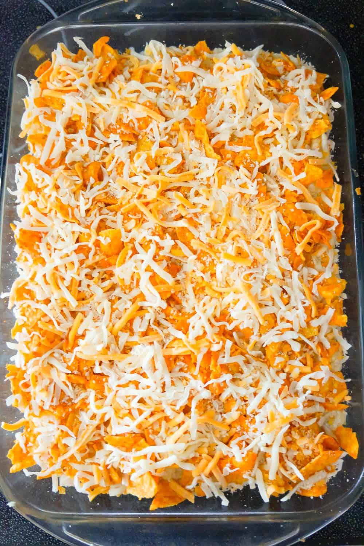 shredded mozzarella and cheddar cheese on top of Doritos casserole