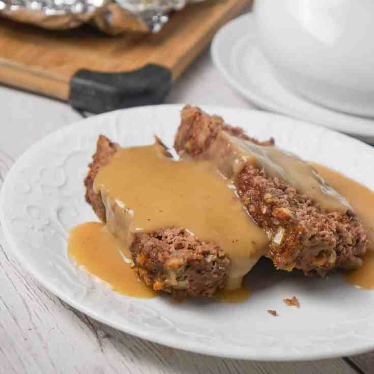 Meatloaf with Gravy is an easy 2 pound ground beef meatloaf recipe made with Stove Top stuffing mix and served with homemade gravy.