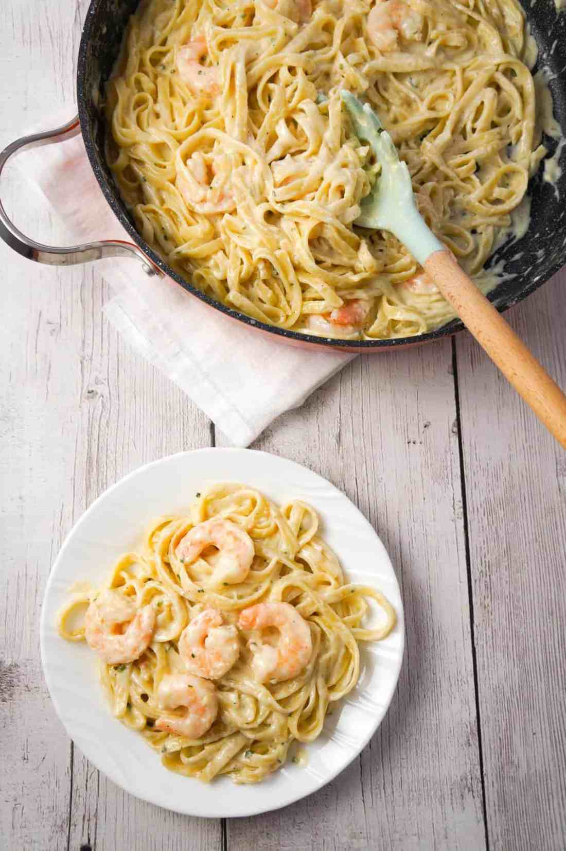 Fettuccine Alfredo with Shrimp is a delicious seafood pasta recipe with a creamy garlic parmesan sauce.