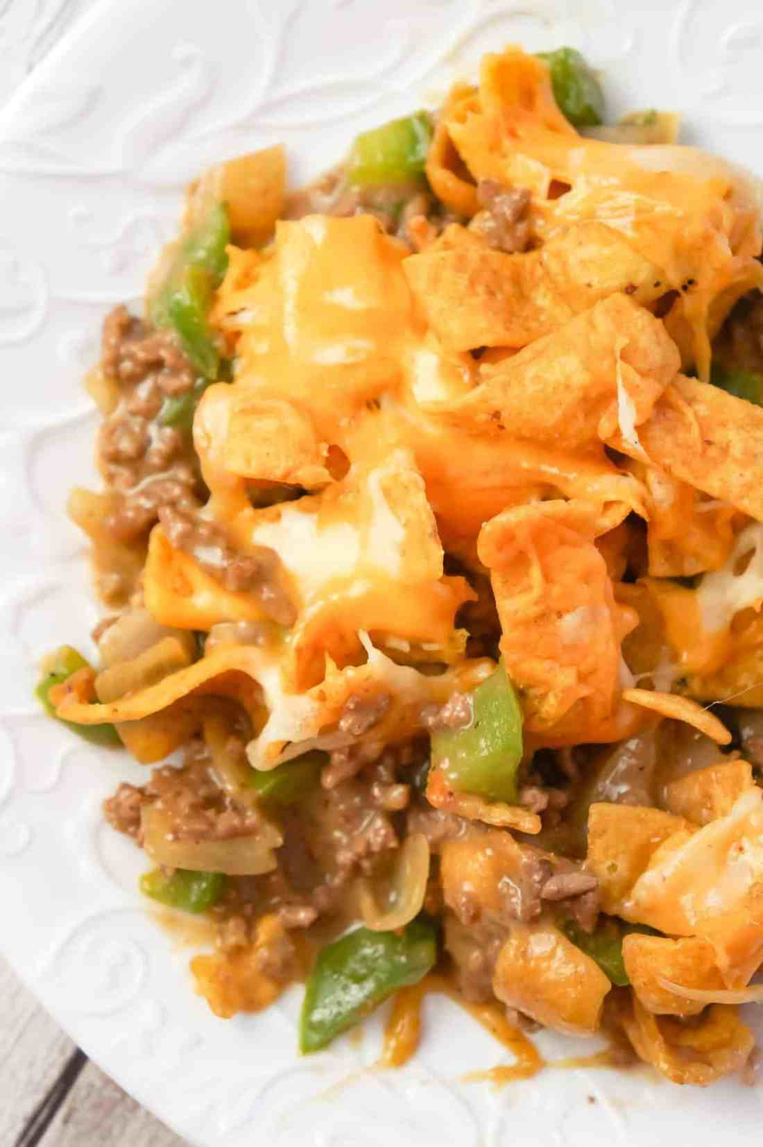Philly Cheese Steak Frito Pie is an easy ground beef casserole recipe loaded with green peppers, onions, Fritos corn chips and shredded mozzarella and cheddar cheese.
