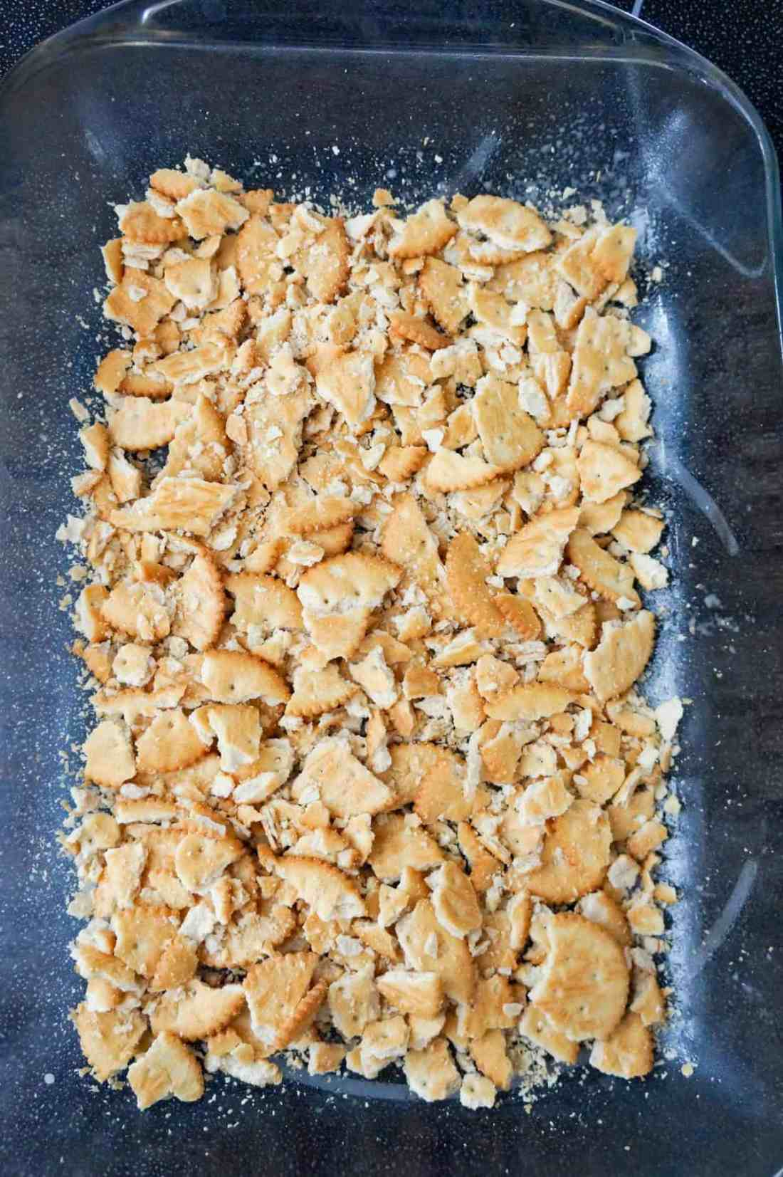 crumbled Ritz crackers in the bottom of a baking dish