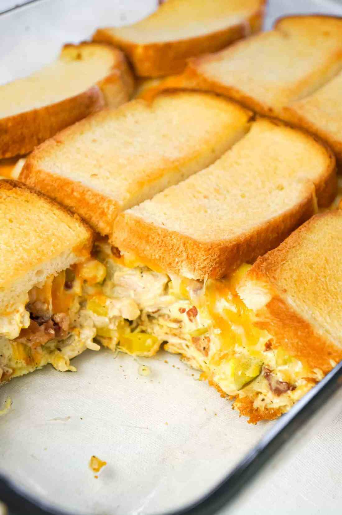 Dill Pickle Chicken Grilled Cheese Casserole is a delicious dinner recipe loaded with shredded chicken, diced dill pickles, crumbled bacon, ranch dressing and cheese all in between layers of toasted bread.