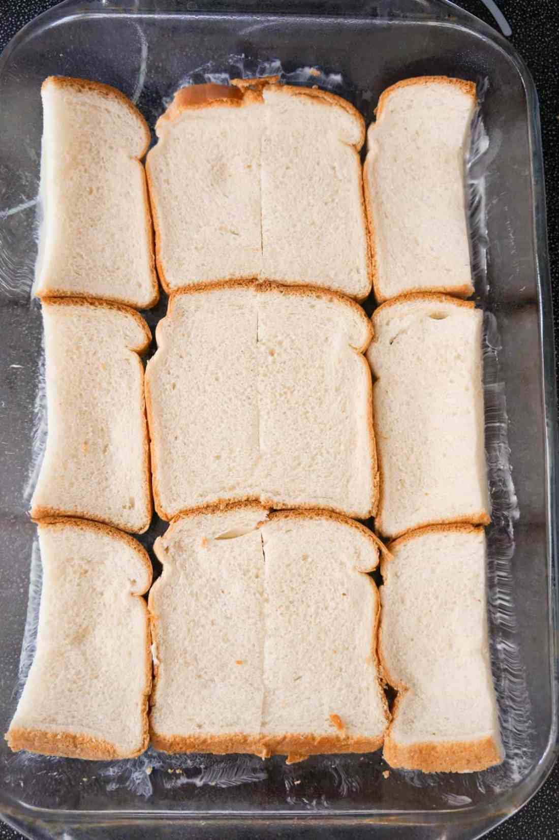 bread slices in the bottom of a baking dish