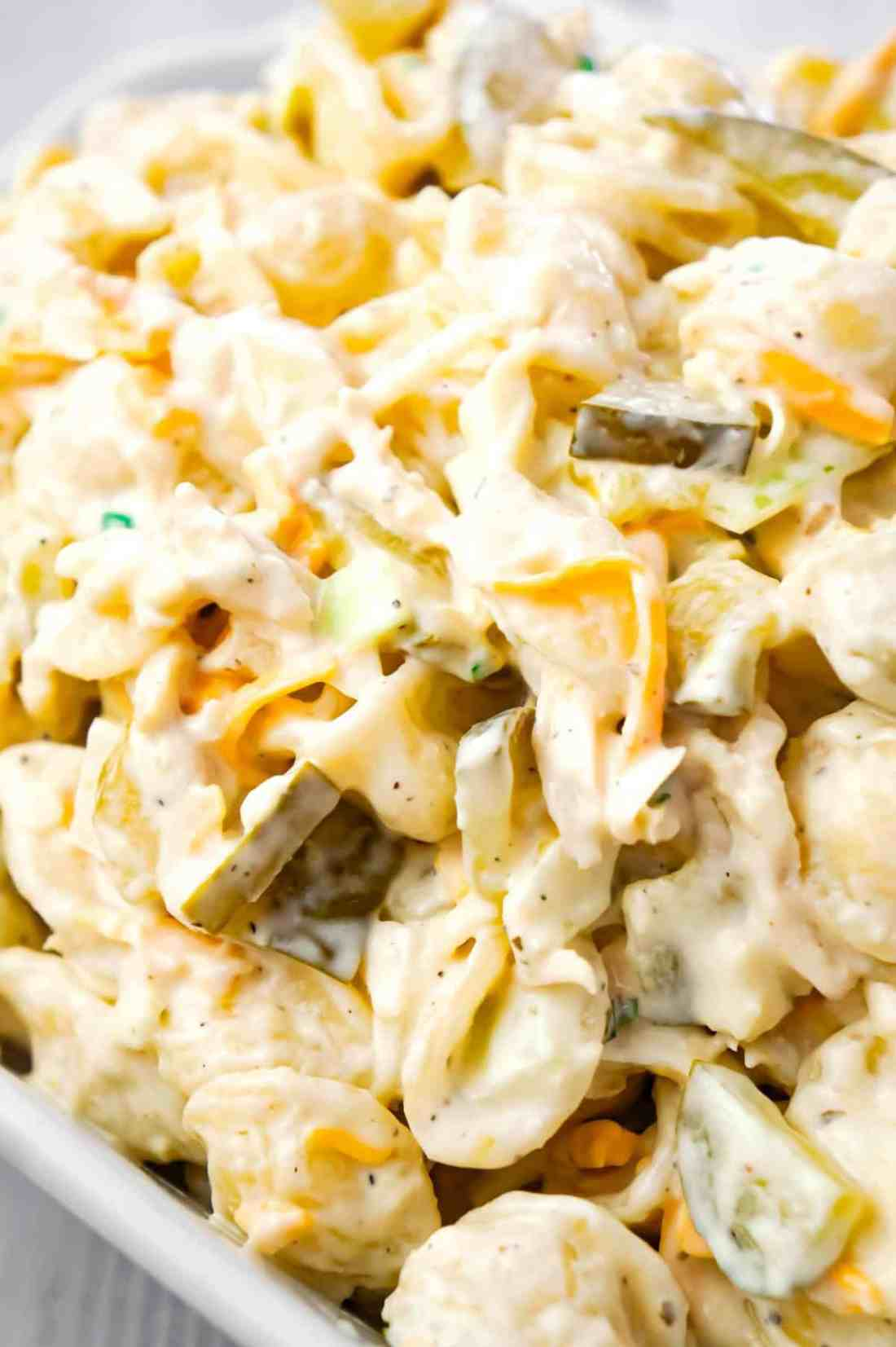 Dill Pickle Chicken Pasta Salad is a delicious cold side dish recipe loaded with shredded chicken, diced dill pickles, mayo, ranch dressing and shredded cheese.