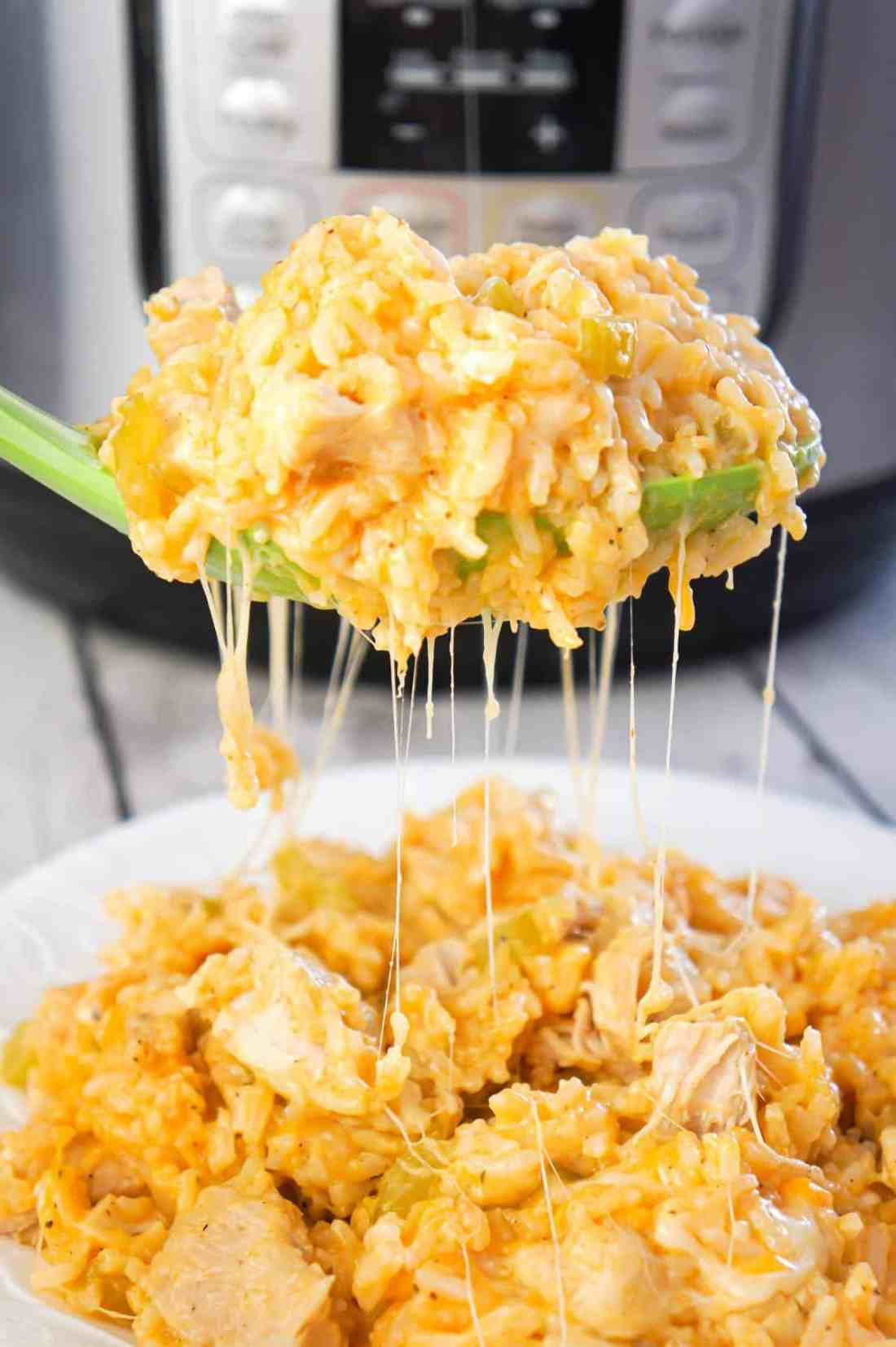Instant Pot Cheesy Buffalo Chicken and Rice is an easy pressure cooker dinner recipe loaded with chicken breast chunks, long grain white rice, diced celery, buffalo sauce and shredded cheese.
