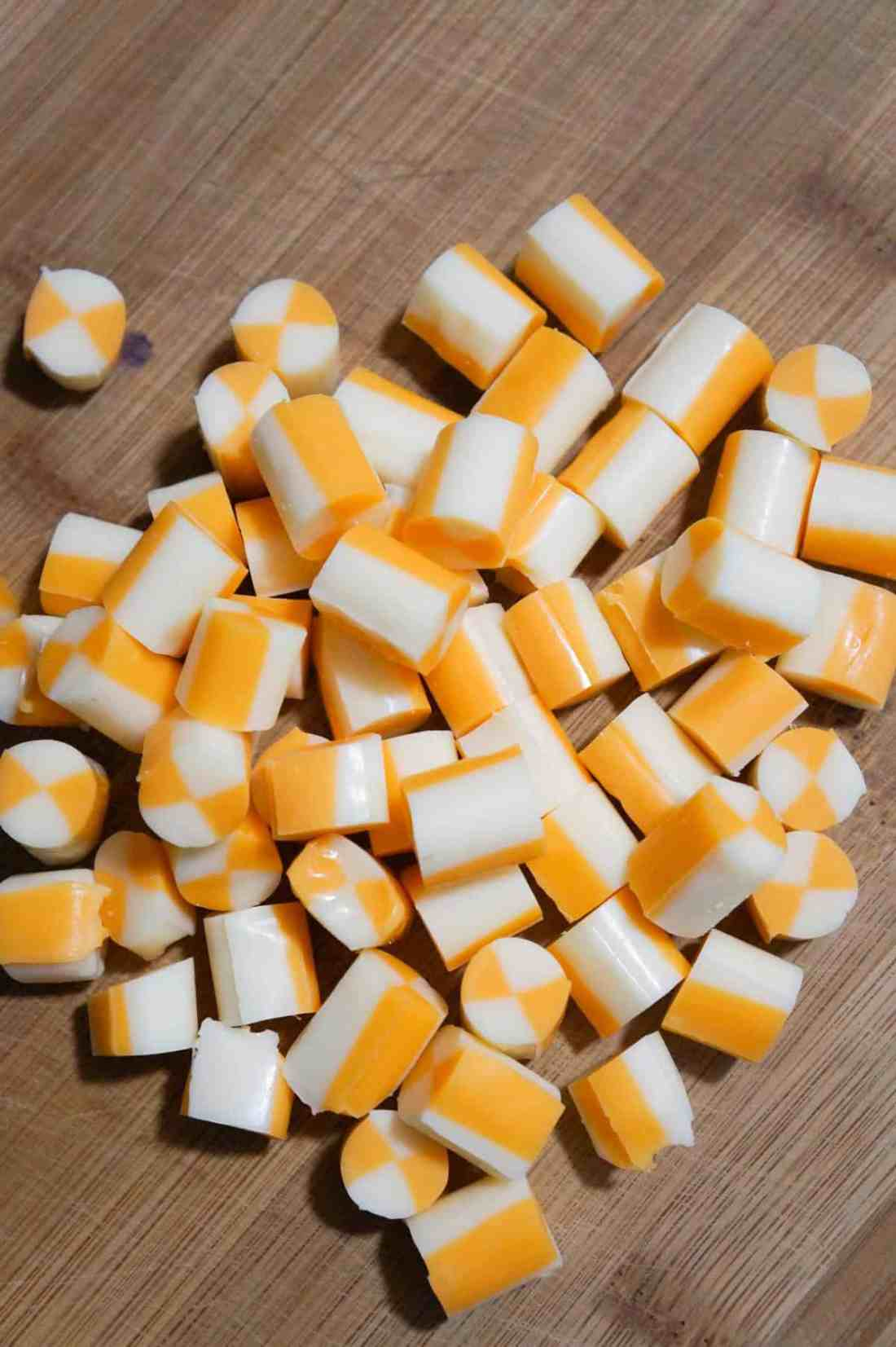 marble string cheese cut into cubes on a cutting board