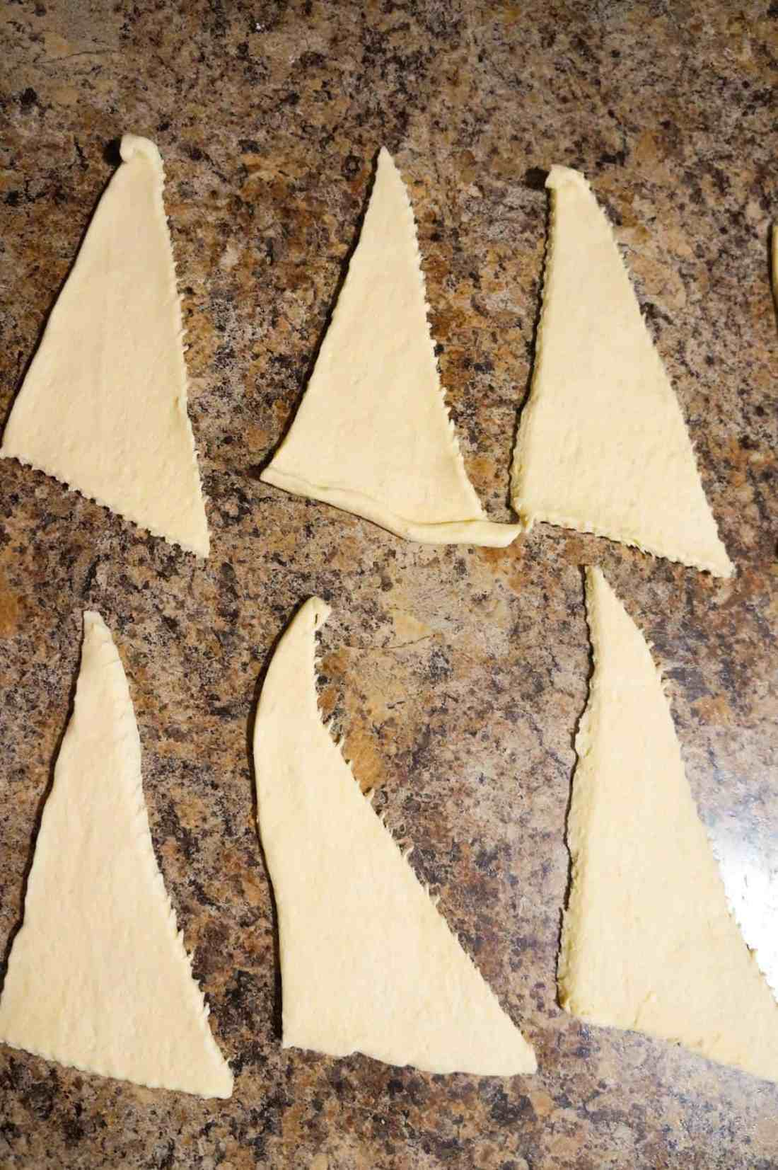 triangles of Pillsbury crescent dough on the counter